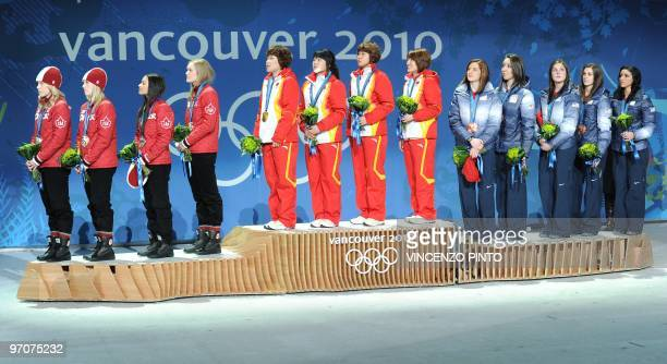 China's gold medalists , Canada's silver medalists and bronze medalists of the US attend the medal ceremony for the women's Speed Skating 3000 m...