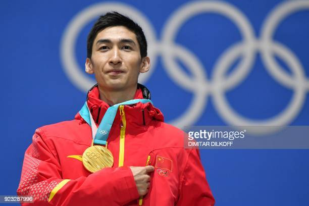 TOPSHOT China's gold medallist Wu Dajing poses on the podium during the medal ceremony for the short track Men's 500m at the Pyeongchang Medals Plaza...