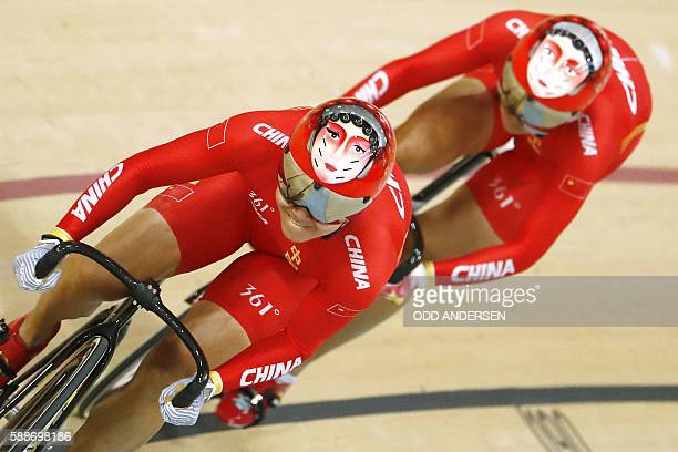 TOPSHOT China's Gong Jinjie and China's Zhong Tianshi compete in the women's Team Sprint qualifying track cycling event at the Velodrome during the...