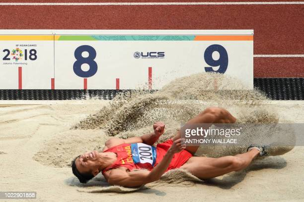 China's Gong Kewei competes in the men's long jump decathlon athletics event during the 2018 Asian Games in Jakarta on August 25, 2018.