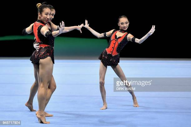 China's group Yushan Duan Qiuqiong Ji and Jieyu Liu perform on the first day of the 26th edition of the Acrobatic Gymnastics world championships in...