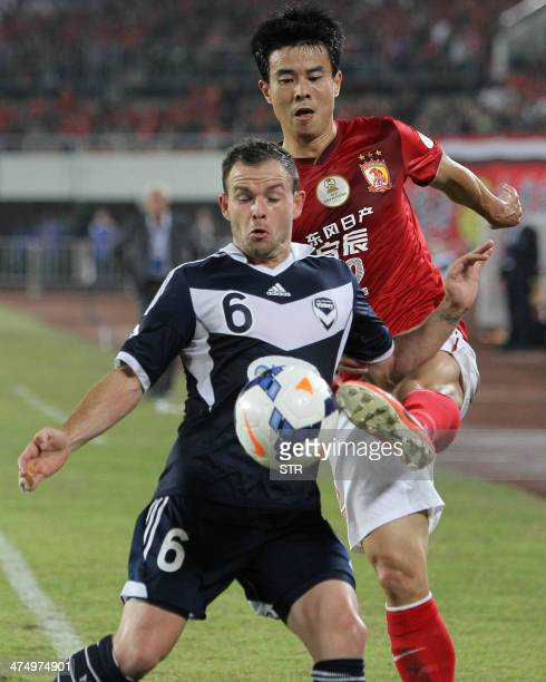 China's Guangzhou Evergrande Sun Xiang tussles for the ball against against Australia's Melbourne Victory Leigh Broxham during the AFC Champions...