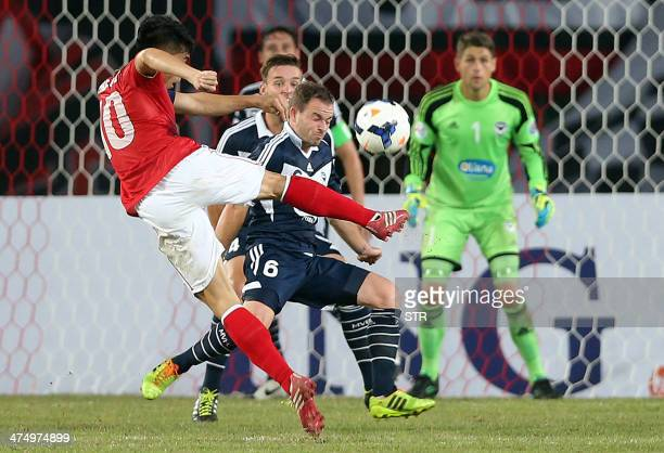 China's Guangzhou Evergrande Zheng Zhi takes a shot at goal against Australia's Melbourne Victory during the AFC Champions League group G first round...