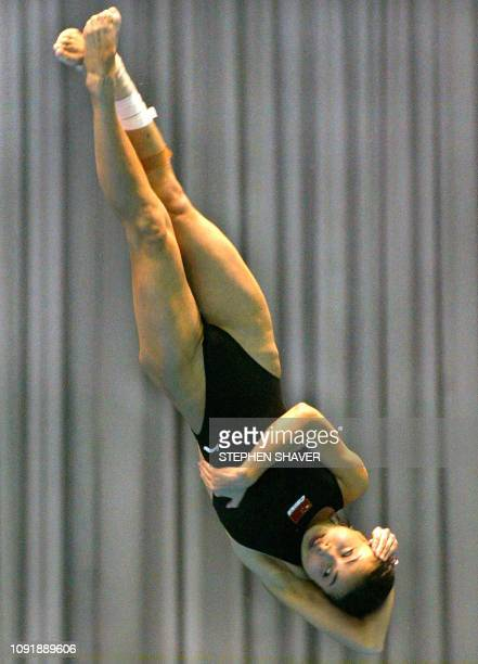 China's Guo Jingjing does a twist during the women's 3metre springboard final 10 October 2002 at the 14th Asian Games in Busan Guo took the gold with...