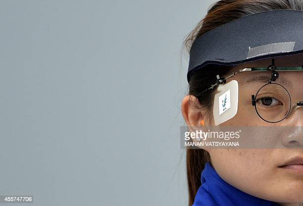 China's Guo Wenjun competes during the women's 10m air pistol individual final of the 2014 Asian Games in Incheon on September 20 2014 China's Zhang...
