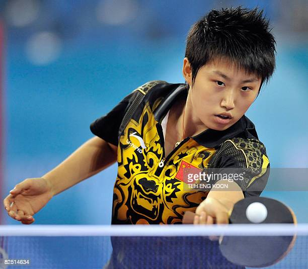 China's Guo Yue hits a return against Singapore's Li Jia Wei during their women's table tennis singles bronze medal match at the 2008 Beijing Olympic...