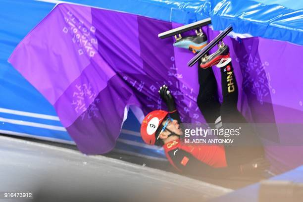 China's Han Tianyu falls during the men's 1,500m short track speed skating heat event during the Pyeongchang 2018 Winter Olympic Games, at the...