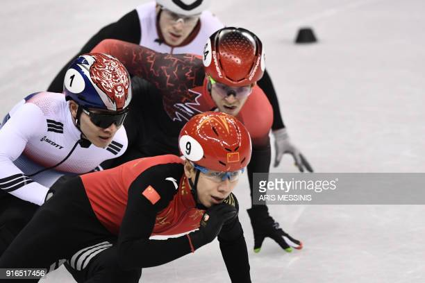 China's Han Tianyu leads in the men's 1500m short track speed skating B final event during the Pyeongchang 2018 Winter Olympic Games at the Gangneung...