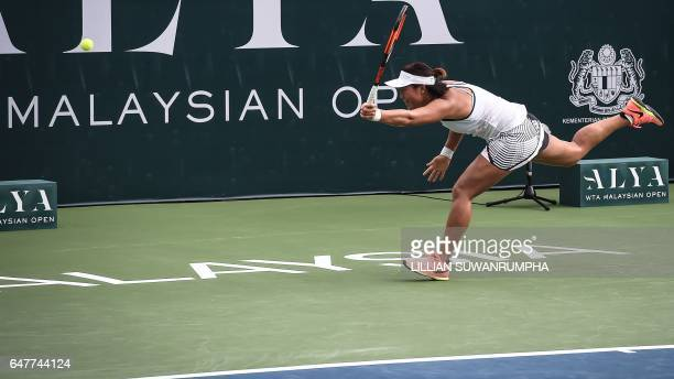 China's Han Xinyun misses a return against Australia's Ashleigh Barty during their singles semi-finals match of the WTA Malaysian Open tennis...