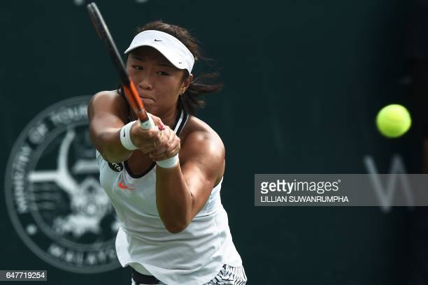 China's Han Xinyun plays a shot against Australia's Ashleigh Barty during their singles semi-finals match of the WTA Malaysian Open tennis tournament...