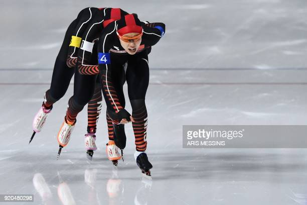TOPSHOT China's Hao Jiachen China's Li Dan and China's Han Mei compete in the women's team pursuit quarterfinal speed skating event during the...