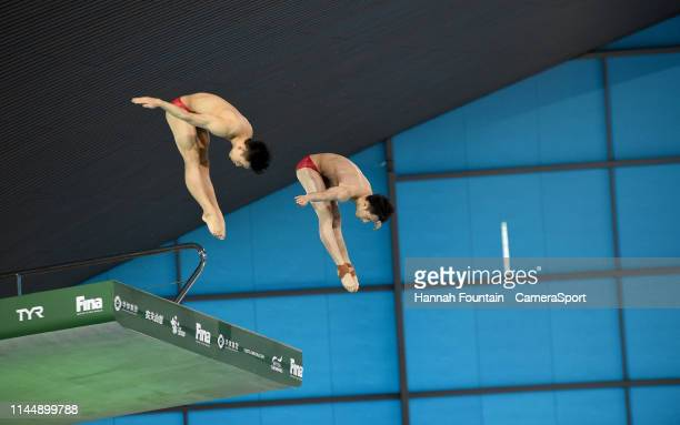 China's Hao Yang and Junjie Lian compete in the Men's 10m Synchro Platform during Day 1 of the FINA/CNSG Diving World Series 2019 at Aquatics Centre...