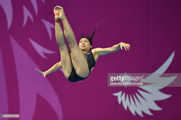 China's He Zi competes in the final of the women's 3m springboard diving event during the 17th Asian Games at the Munhak Aquatics Center in Incheon...