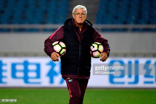China's head coach Marcello Lippi attends a training session in Chongqing southwest China on November 13 ahead of their international friendly...