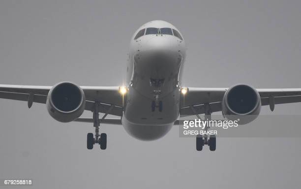 China's homegrown C919 passenger comes in to land at Pudong International Airport on its maiden flight in Shanghai on May 5 2017 The first large...