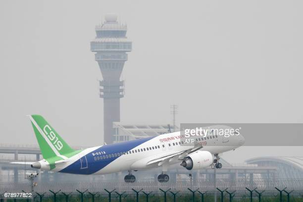China's homegrown C919 passenger jet takes off on its first flight at Shanghai Pudong International Airport in Shanghai on May 5 2017 The first...