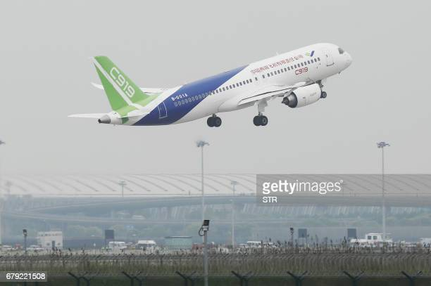 China's homegrown C919 passenger takes off on its maiden flight at Pudong International Airport in Shanghai on May 5 2017 The first large madeinChina...