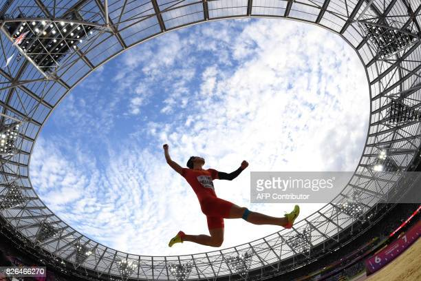 TOPSHOT China's Huang Changzhou competes in the qualifying round of the men's long jump athletics event at the 2017 IAAF World Championships at the...
