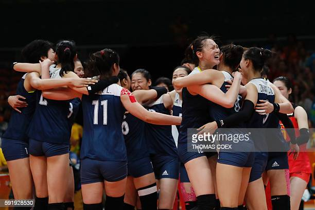 TOPSHOT China's Hui Ruoqi and teammates hug each other after winning their women's semifinal volleyball match against the Netherlands at...