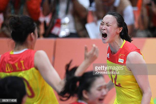 China's Hui Ruoqi celebrates after winning the women's Gold Medal volleyball match against Serbia at Maracanazinho Stadium in Rio de Janeiro on...