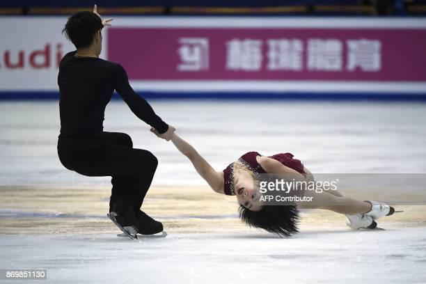 China's ice skaters Sui Wenjing and Han Cong perform in Pairs Short Program during the Cup of China ISU Grand Prix of Figure Skating in Beijing on...