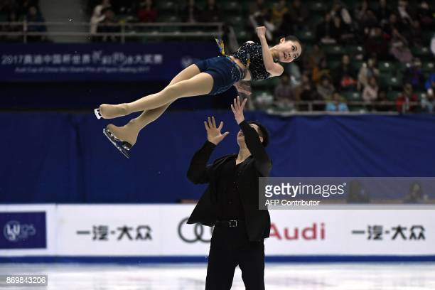 China's ice skaters Zhang Mingyang and Song Bowen perform in Pairs Short Program during the Cup of China ISU Grand Prix of Figure Skating in Beijing...