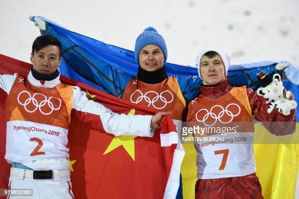 China's Jia Zongyang Ukraine's Oleksandr Abramenko and Russia's Ilia Burov celebrate on the podium during the victory ceremony after the men's...