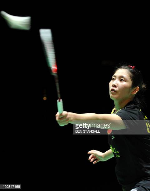 China's Jiang Yanjiao returns a shot to Germany's Juliane Schenk during round 16 of the women's singles in the World Badminton Championships at...