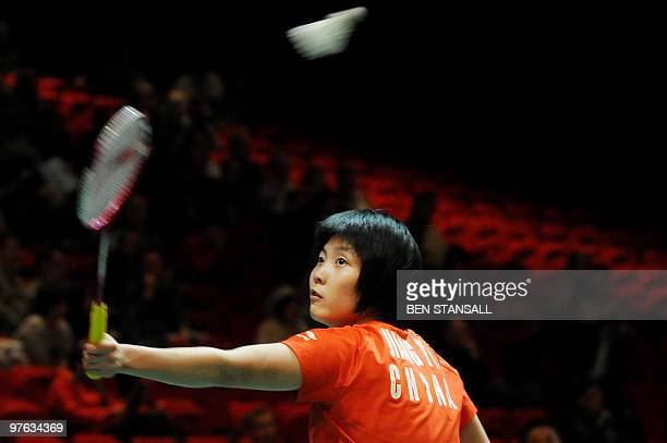 China's Jiang Yanjiao return's a shot to Indonesia' Maria Febe Kusumastuti during their women's singles second round match at the Badminton All...