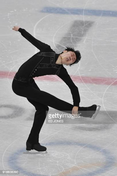 China's Jin Boyang competes in the men's single skating short program of the figure skating event during the Pyeongchang 2018 Winter Olympic Games at...