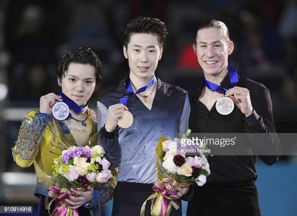 China's Jin Boyang poses for a photo after winning the men's title at the Four Continents Figure Skating Championships in Taipei on Jan 27 alongside...