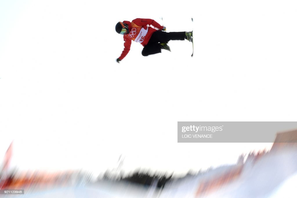 TOPSHOT - China's Kong Xiangrui competes in the men's ski halfpipe qualification event during the Pyeongchang 2018 Winter Olympic Games at the Phoenix Park in Pyeongchang on February 20, 2018. /