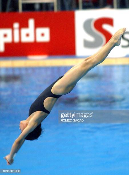 China's Lao Li Shi performs her dive during the women's 10m platform diving final at the 14th Asian Games in Busan 12 October 2002 Lao accumulated a...