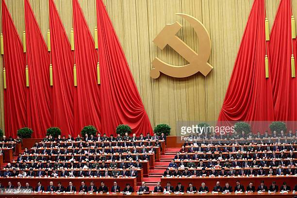 China's leaders gather during the closing session of the 18th National Congress of the Communist Party of China inside the Great Hall of the People...