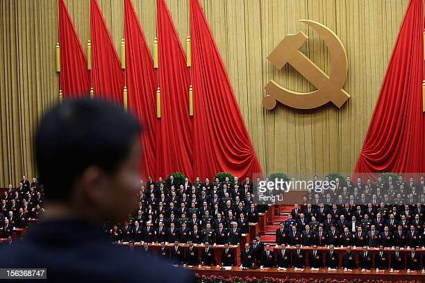 China's leaders stand as they listen to 'the Internationale' during the closing session of the 18th National Congress of the Communist Party of China...