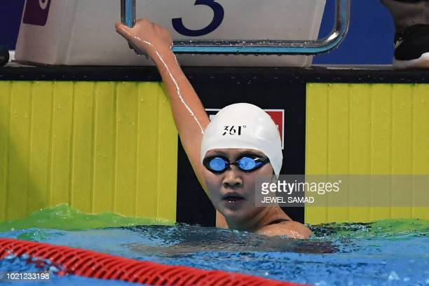 China's Li Bingjie reacts after winning the final of the womens 200m freestyle swimming event during the 2018 Asian Games in Jakarta on August 22 2018
