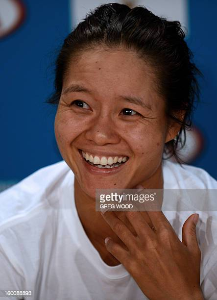 China's Li Na gestures as she answers a question during a press conference following defeat in her women's singles final against Belarus's Victoria...