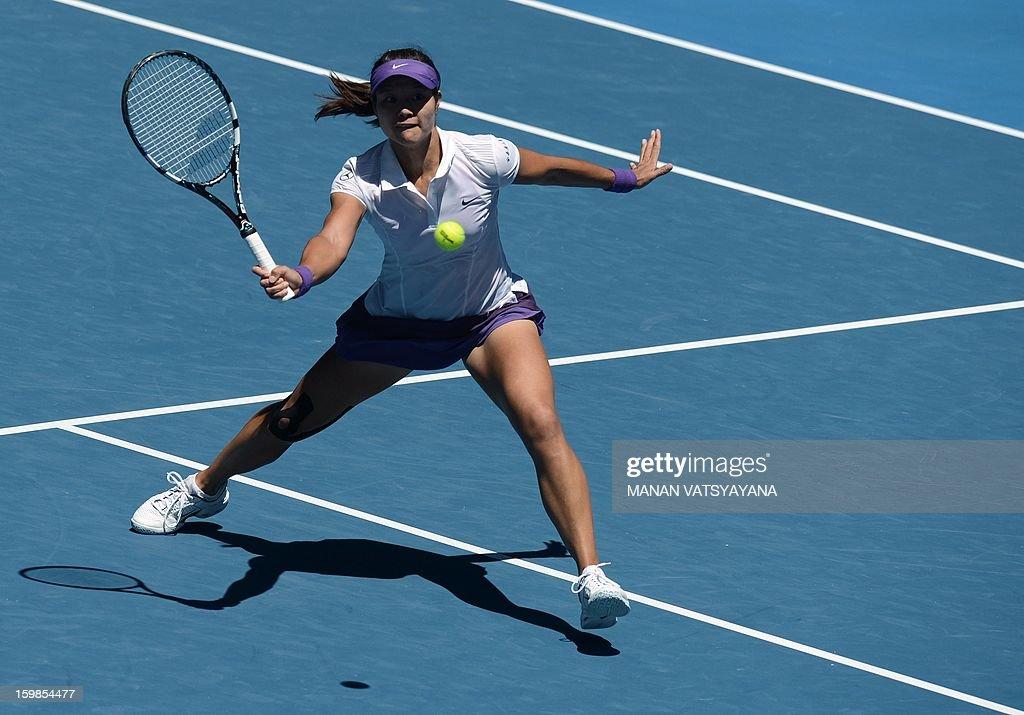 China's Li Na hits a return against Poland's Agnieszka Radwanska during their women's singles match on day nine of the Australian Open tennis tournament in Melbourne on January 22, 2013.