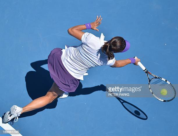 China's Li Na hits a return against Russia's Maria Sharapova during their women's singles semifinal match on day 11 of the Australian Open tennis...