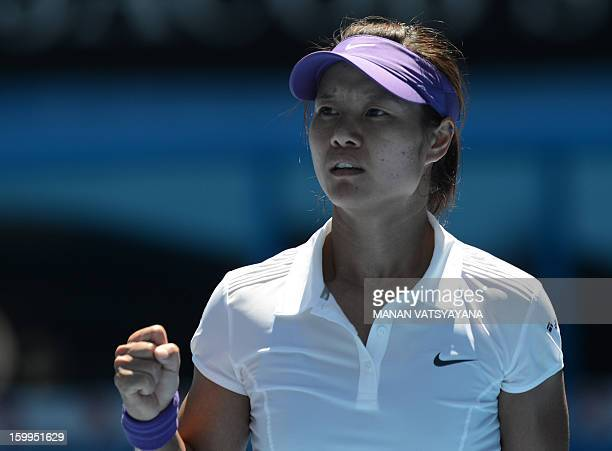 China's Li Na reacts after a point against Russia's Maria Sharapova during their women's singles semifinal match on day 11 of the Australian Open...