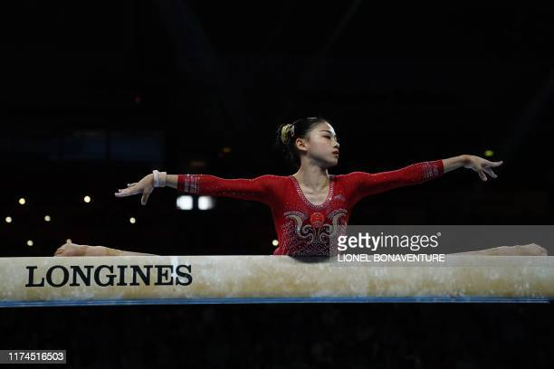 China's Li Shijia performs on the floor during the womens team final at the FIG Artistic Gymnastics World Championships at the...