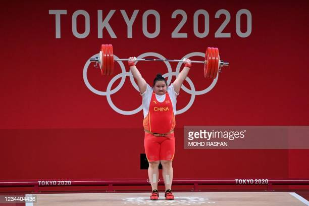 China's Li Wenwen competes in the women's +87kg weightlifting competition during the Tokyo 2020 Olympic Games at the Tokyo International Forum in...