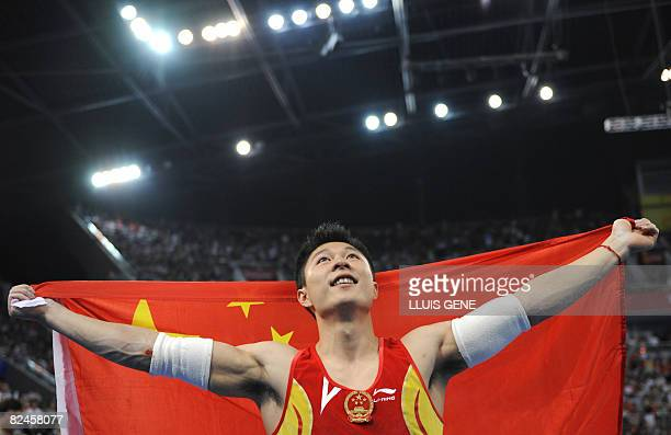 China's Li Xiaopeng celebrates after winning the gold medal in the men's parrallel bars final of the artistic gymnastics event of the Beijing 2008...