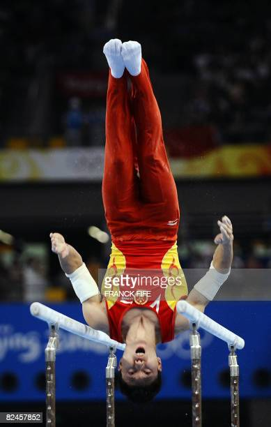 China's Li Xiaopeng competes in the men's parrallel bars final of the artistic gymnastics event of the Beijing 2008 Olympic Games in Beijing on...