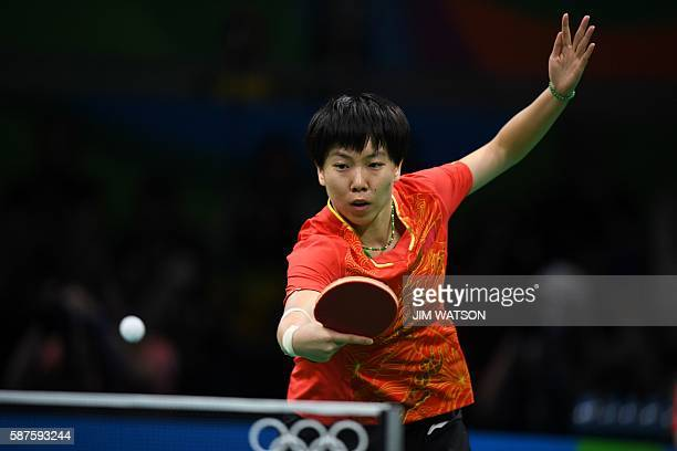 China's Li Xiaoxia hits a shot against Taiwan's Cheng IChing in their women's singles quarterfinal table tennis match at the Riocentro venue during...