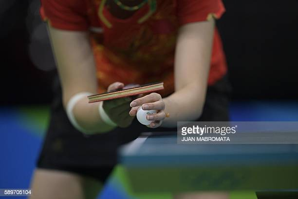 TOPSHOT China's Li Xiaoxia prepares to serve in the women's team semifinal table tennis match against Singapore at the Riocentro venue during the Rio...