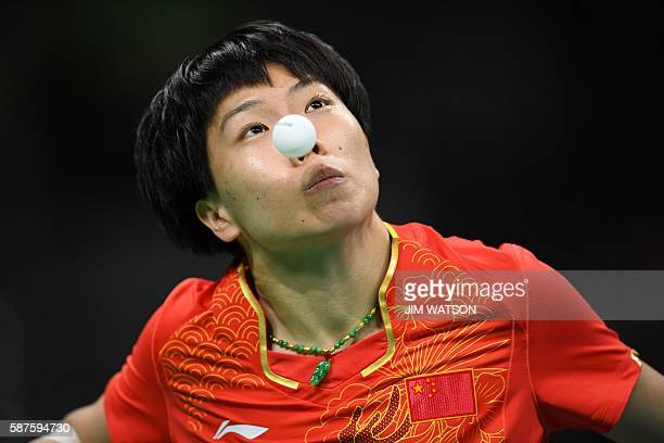 China's Li Xiaoxia serves against Taiwan's Cheng IChing in their women's singles quarterfinal table tennis match at the Riocentro venue during the...