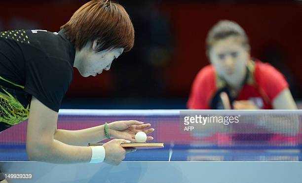 China's Li Xiaoxia serves the ball toward Japan's Ai Fukuhara during their 2012 London Olympic Games table tennis women's team gold medal matches at...