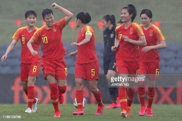 Chinas Li Ying celebrates scoring a goal with her teammates during the women's Olympic football tournament qualifier match between China and Thailand...
