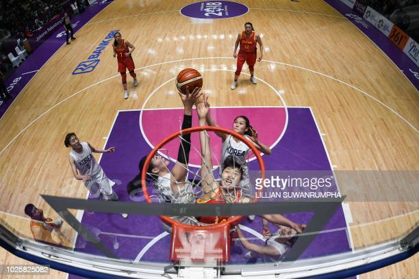 China's Li Yueru competes for the ball during the women's gold medal basketball match between Unified Korea and China at the 2018 Asian Games in...